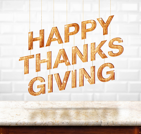 Happy Thanksgiving wood texture on marble table with white ceramic tile wall,Holiday concept. Stock Photo