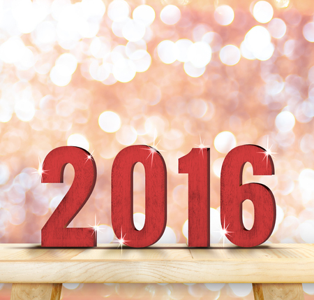 new years eve: Red 2016 year wood number on wooden table top with sparkling pink bokeh,Holiday mock up , leave space for adding text. Stock Photo