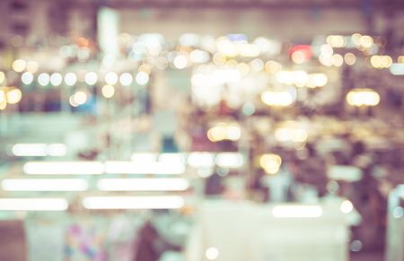 exhibitions: Blurred background : Top view of people walking in exhibition hall.