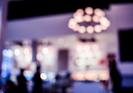 blurred people: Blurred background, Counter bar at night club with bokeh light. Stock Photo