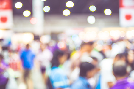 expo: Blurred background : crowd of people in expo fair with bokeh light . Stock Photo