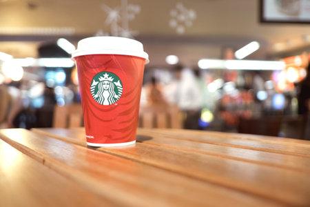 starbucks coffee cup on wood table