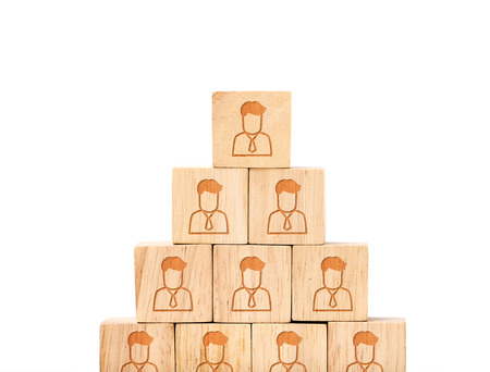close icon: close up at People profile icon on wood cube arrange in pyramid shape ,business concpt mock up..