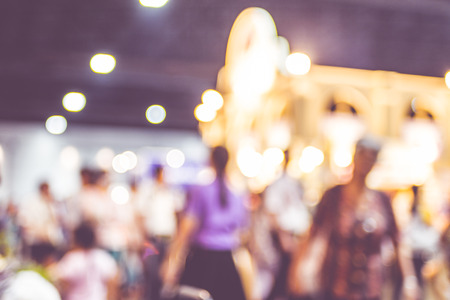 Blurred background : crowd of people in expo fair with bokeh light . Stock Photo