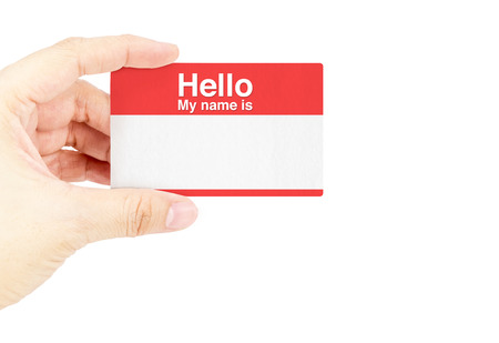 hello my name is: Hand holding business card with Hello My name is with white background.