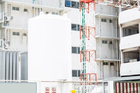 storage tank: Big Storage tank at building. Stock Photo