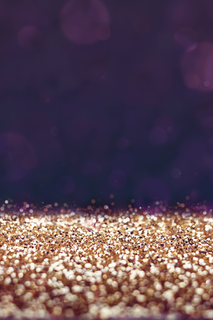 black and gold: Vintage filter, Gold glitter floor with purple bokeh background, Perspective space for adding your product.