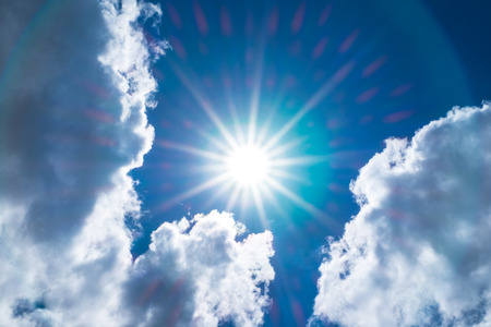 glory: Looking up at Nice blue sky with sun beam and halo with cloudy.
