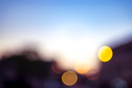 ble: Blurred background,Blue sky with silhouettes building in evening time with boke light. Stock Photo