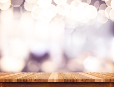 Empty perspective wood plank table top with abstract bokeh light background,Mock up for montage of your product.