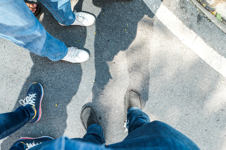 aerial view of people stand in a group on grunge concrete floor.