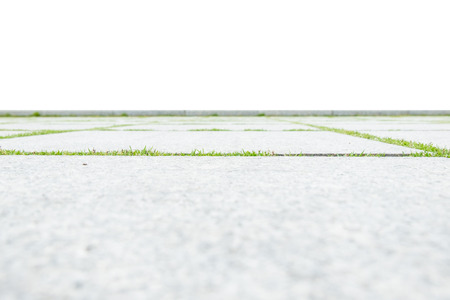 low angle views: low angle view of concrete floor with green grass isolated on white background.