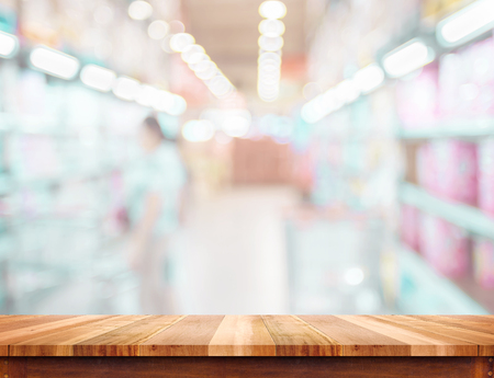 blurred: Empty wood table and blurred supermarket background. product display template.Business presentation. Stock Photo