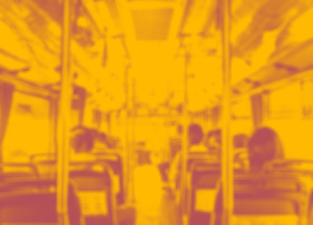 duo tone: Abstract blur background, Inside of public bus with seat and people in duo tone color style. Stock Photo
