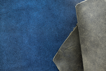 animal vein: Close up fold grain grey and navy blue leather texture background,fabrics Division. Stock Photo