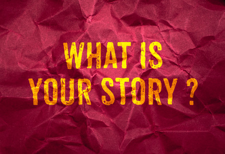 story: What is your story? in gold texture on crumpled red paper background,business concept.
