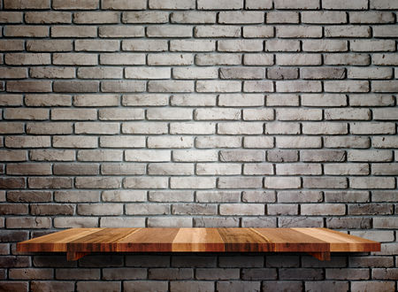 brick texture: Empty wooden shelfs on pastel grunge brick wall, Mock up template for display of product.