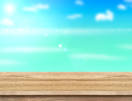 turquoise: Wood table top with blurred sea,sun and beach at background, Mock up template for display or montage of your product, Summer holiday concept.