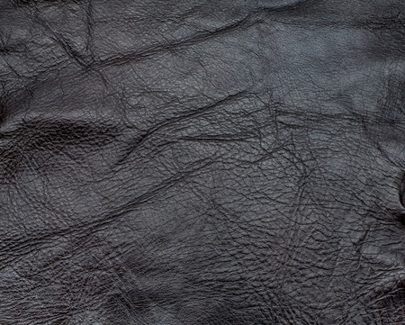 distressed: Close up dark brown color crumpled leather texture background?