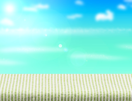 background summer: green table cloth table top with blurred sea,sun and beach at background, Mock up template for display or montage of your product, Summer holiday concept.