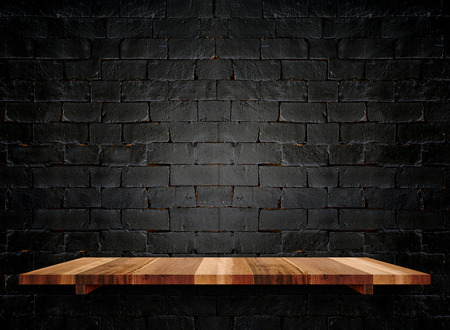 Empty wooden shelfs on pastel grunge black brick wall, Mock up template for display of product. Фото со стока