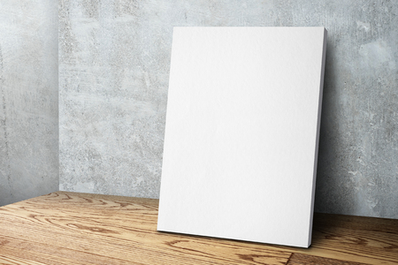 Blank white canvas frame leaning at concrete wall and wood floor, Mock up template for adding your design