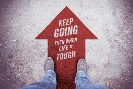 to move forward: Inspiration quote: Keep going even when life is tough on aerial view of shoe on road with move forward red arrow