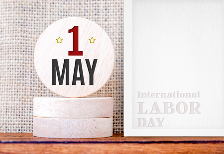jornada de trabajo: 1 May day (International Labor day) on round wood and photo frame,holiday concept