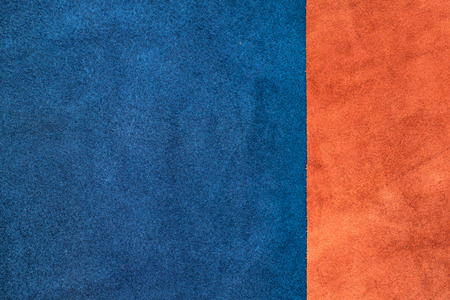 ornage: Close up suede navy blue and orange leather divide at one third ratio texture background,fabrics Division, Stock Photo