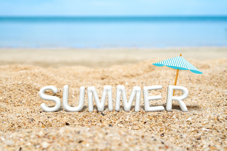 Summer (3D Rendering text) white word with beach umbrella on sand beach and blue sea blur background,Summer Vacation concept.