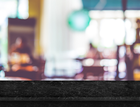 marble background: Empty luxury black marble table top with blurred garden cafe bokeh light as background. Mock up for display or montage of product,Business presentation.
