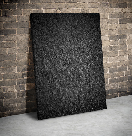 black block: Blank black rough stone block on the grunge brick wall and cement floor,Mock up to display or montage of your content Foto de archivo