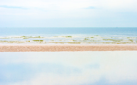sky reflection: Landscape view of sea and sand beach with reflection of blue sky ,Summer concept