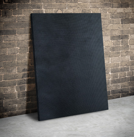cement floor: Blank black fabric poster on the grunge brick wall and cement floor,Mock up to display or montage of your content. Stock Photo