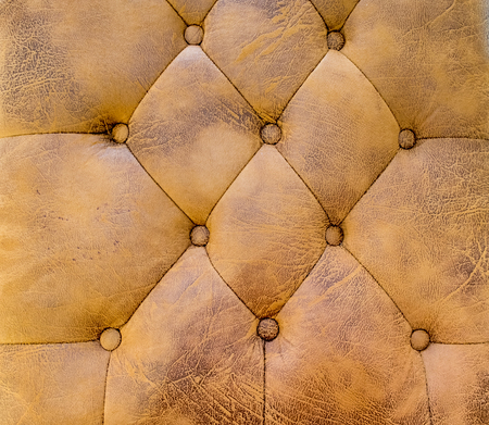 brown leather sofa: Close up brown leather sofa texture background.