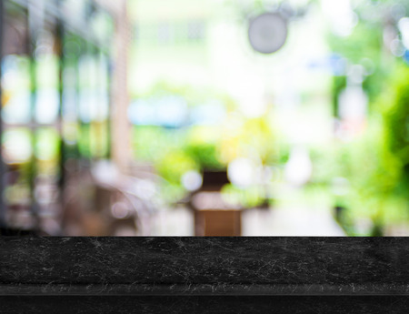 marble background: Empty luxury black marble table top with blurred cafe bokeh light as background. Mock up for display or montage of product,Business presentation. Stock Photo