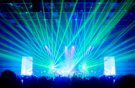 laser show: Blurred background,Bokeh lighting in concert with audience ,Music showbiz concept. Stock Photo
