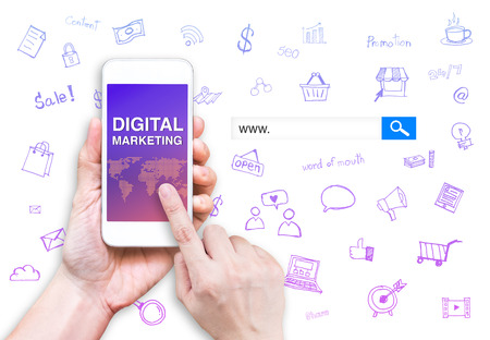 Hand touch mobile phone with Digital marketing word with search box and doodle features  at white background, Digital marketing business concept.