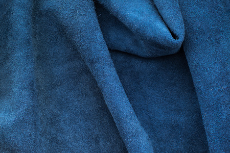 navy blue background: Close up fold navy blue leather texture background,fabrics Division.