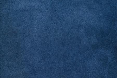 Close up blue color crumpled leather texture background. Foto de archivo