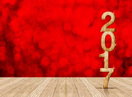 christmas lights display: Happy New Year 2017 number in perspective room with red sparkling bokeh lights and wooden plank floor,Leave space for display or montage of your content. Stock Photo