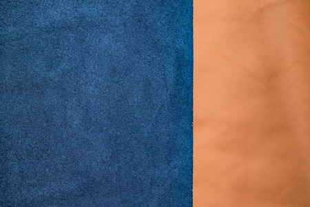 ornage: Close up navy blue and tan leather divide two section, texture background,fabrics Division. Stock Photo