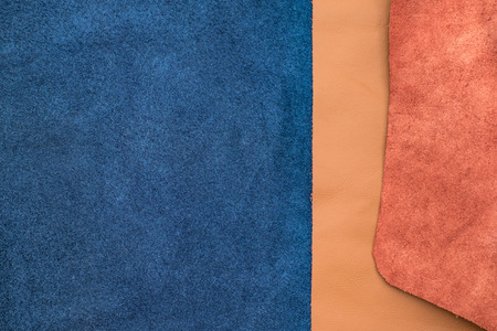 division: Close up navy blue and tan leather divide two section, texture background,fabrics Division. Stock Photo