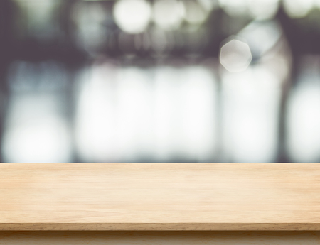 Empty wood table top with office building hall way blur background with bokeh light,Mock up for display or montage of product,Business presentation. Stockfoto