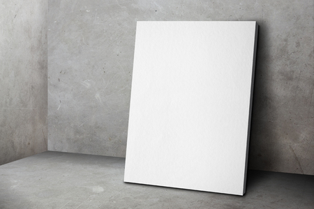 white poster: Blank white poster frame leaning at grunge grey concrete wall and floor, Mock up template for adding your design. Stock Photo