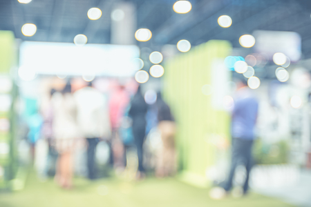 Blurred background: crowd of people in expo fair with bokeh light ,Vintage filtered. Stock Photo