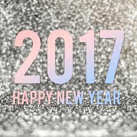 color of year: happy new year 2017 in material color at silver sparkling glitter background.