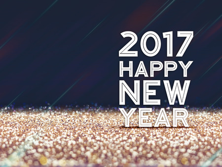 glitter background: 2017 Happy New year in gold and dark purple color abstract glitter background, Holiday concept design,Leave space for adding your content.