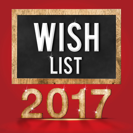 wish  list: 2017 wish list wood texture number with Goals word on blackboard at red studio backdrop,Business vision concept.
