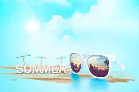 sunglasses reflection: Sunglasses reflection sunset at palm tree landscape and beach umbrella with sand with summer word (3d rendering) at blue sky and sun,Summer Time concept,Leave space for adding your content or text. Stock Photo